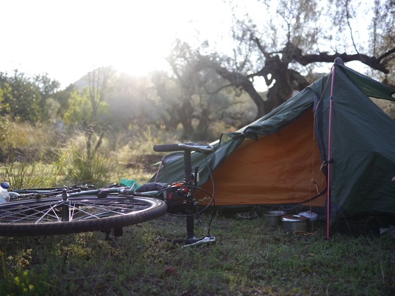 camping in field cycle touring