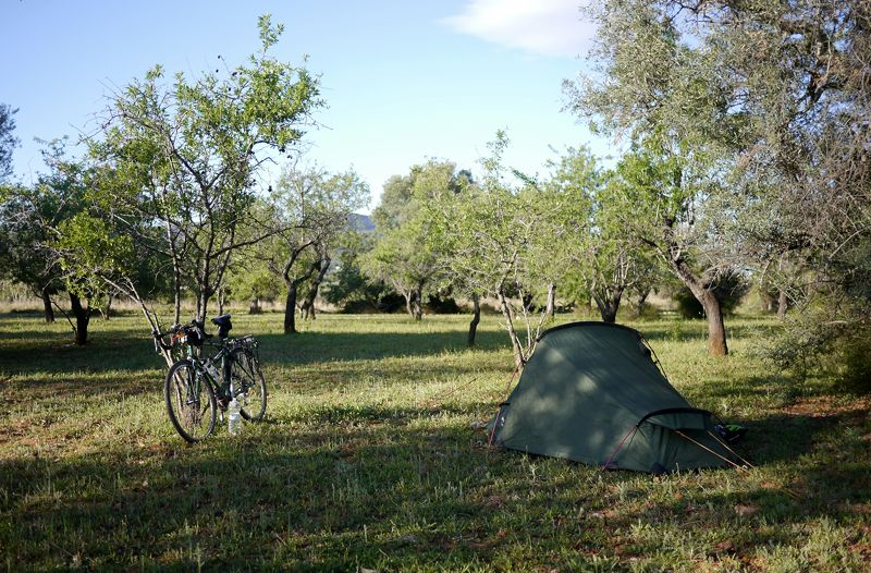 camping in orchard cycle touring