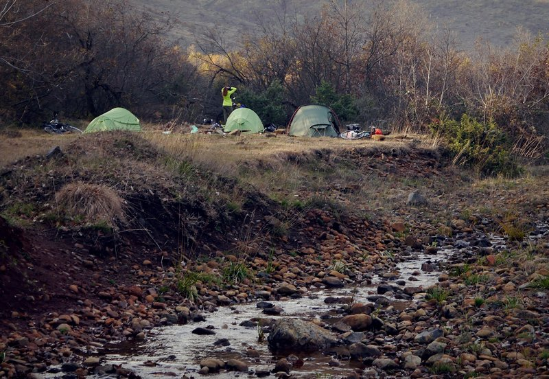 Tents and wild camping in Kosovo next to river.