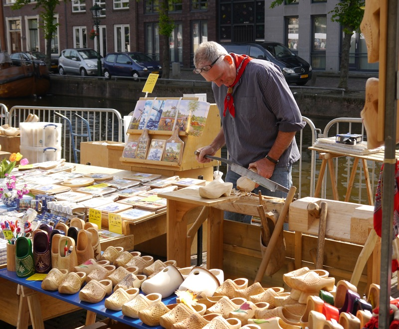 A man makes clogs by hand at the market in Alkmaar.