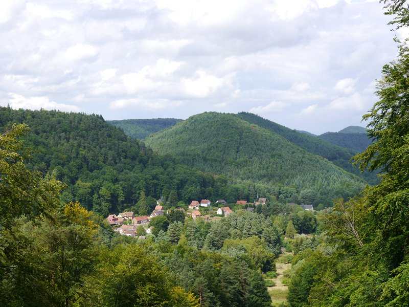 A village lies nestled in the hIlls on the French German border.