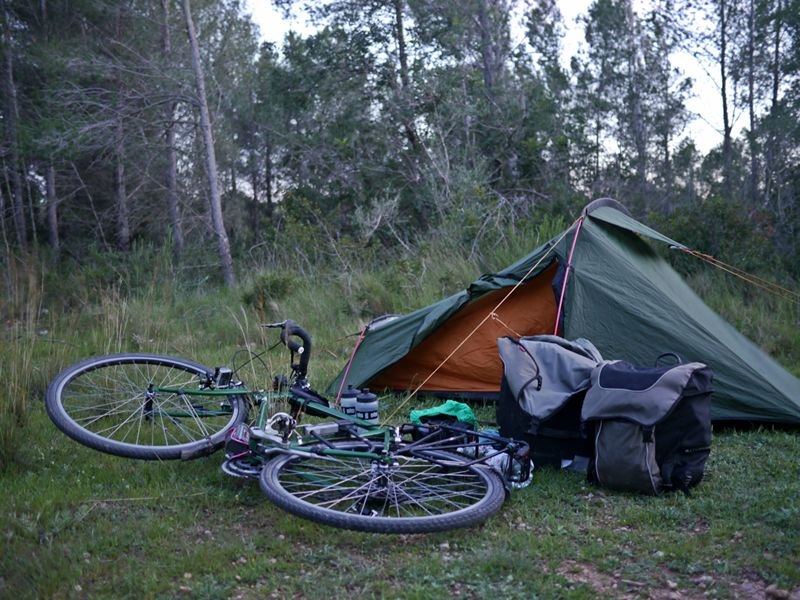 camping in the woods with bike
