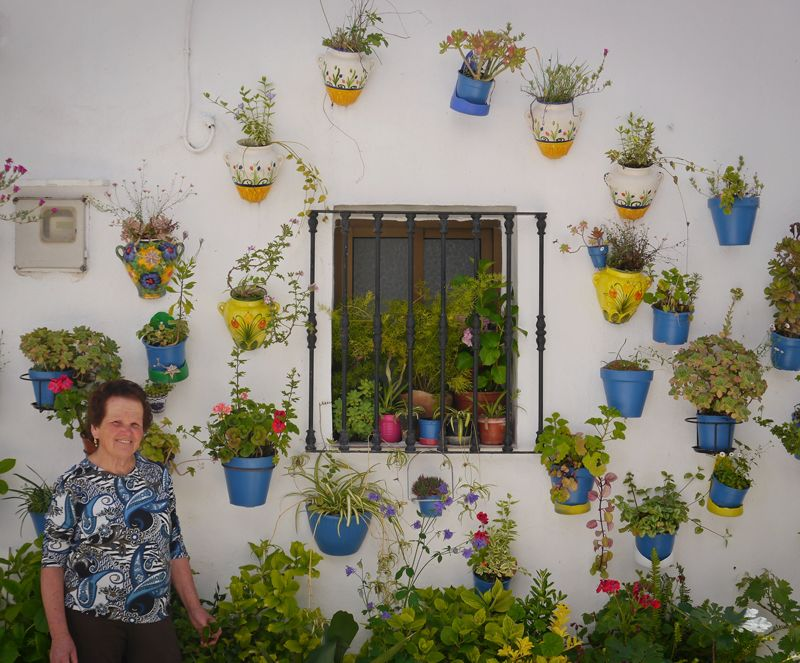 Spanish lady with her plants