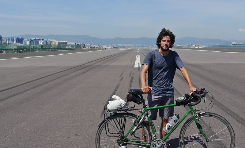 Jamie and bike on the runway in Gibraltar