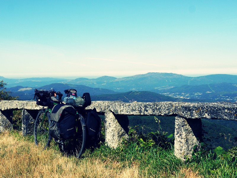 bicycle with the hills of Galicia in background