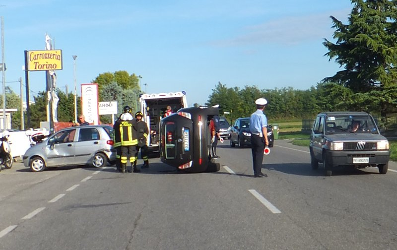 car on its side on italian road