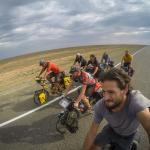 7 cyclists cycling the Kazakhstani desert. (the Kylylkum desert in Kazakhstan)