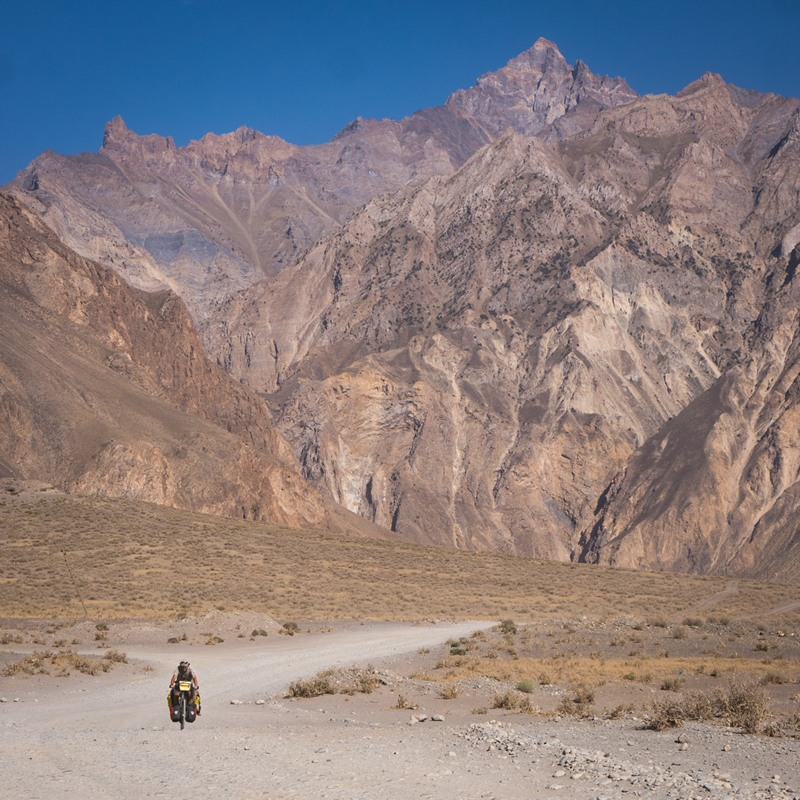 Cycling next to huge mountains in Tajikistan
