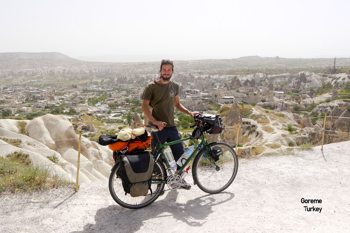 This image shows Jamie and his bicycle in Goreme, China