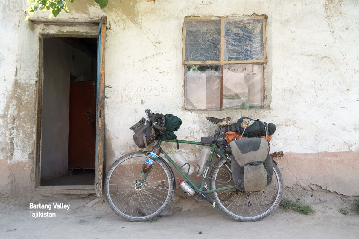 Bicycle leaning against Pamir House, Tajikistan