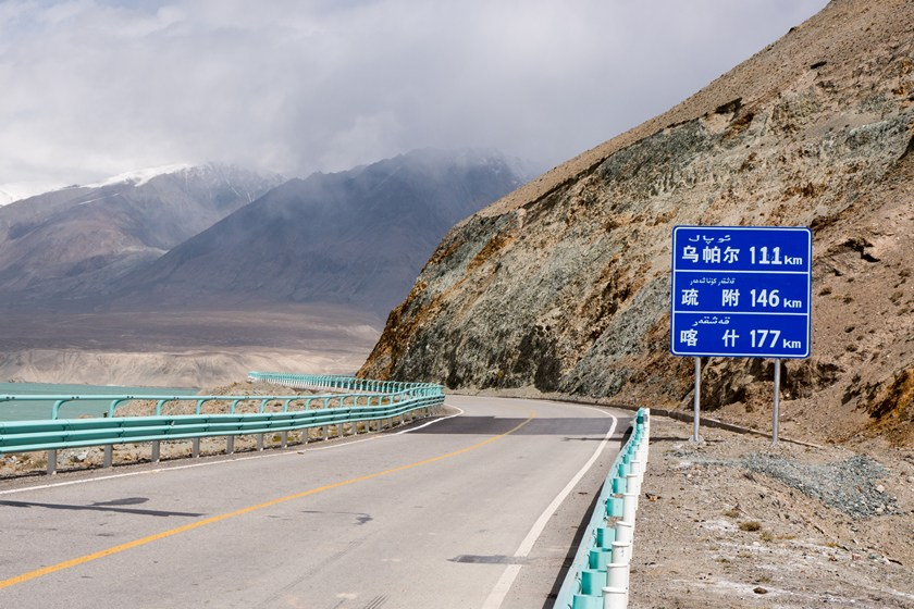 Road sign in Xinjiang region China showing both Chinese and Uyghur language
