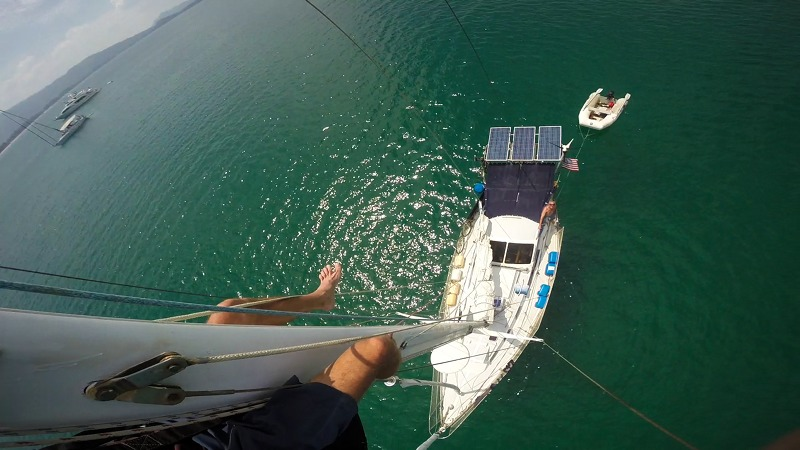 me climbing the mast of a sailboat
